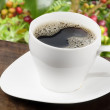 White coffee cup with coffee beans background - Stock Photo