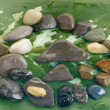 Zen stones pyramid color sheet surface — Stock Photo