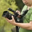 Man with video camera in the hands — Stock Photo