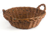 Empty brown wicker basket isolated on the white background — Stock Photo