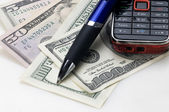 Dollars, a pen and cell — Stock Photo