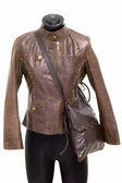 Jacket and luxury leather boot in a dummy — Stock Photo
