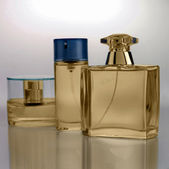 Gold perfume bottles — Stock Photo