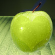 Green apple with heart — Stock Photo