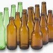Bottles of beer on white background — Stok fotoğraf