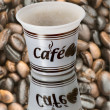 Plastic cups with coffee background coffee beans — Stock Photo #9122824
