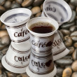 Plastic cups with coffee background coffee beans — Stock Photo