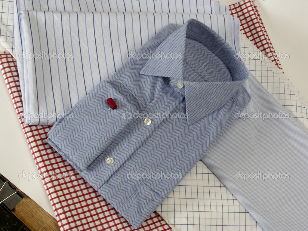 On a blue shirt pinstripes — Stock Photo #9585695