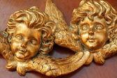 Golden angelic faces — Stock Photo