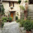 Courtyard in tuscan village - Stock Photo