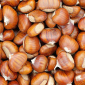Sweet chestnuts as backdrop — Stock Photo