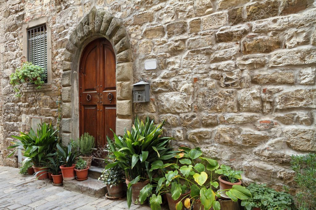 Stony antique wall with framed arc door in italian village, Tuscany, Montefioralle   Stock Photo #8310780