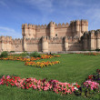 View of castle of Coca and colorful flowerbeds — Stock Photo
