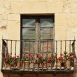 Idyllic balcony with red flowers — Foto Stock