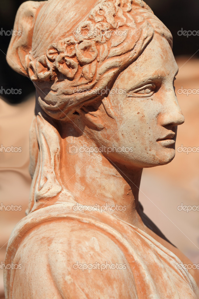 Beautiful classic female statue decoration in terracotta, Impruneta , Florence, Italy — Stock Photo #8517958