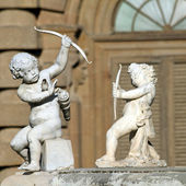 Two Cupids with bow — Stok fotoğraf