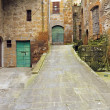 Street in antique small italian town — Stock Photo