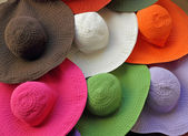 Colorful summer hats in shop window — Stock Photo