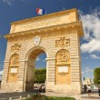 Triumphal arch and main promenade in Montpellier, France - Stock Photo