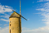 Stony windmill with plane in the Breton, French countryside — Stock Photo