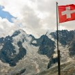 swiss flag with view of dolent glacier in swiss alps — Stock Photo