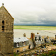 Landscape from Mont Saint Michel - stone church with Norman houses and bay of Mont Saint Michel — Stok fotoğraf
