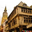 Medieval street with timber-framed houses, Dinan, France - Stock Photo