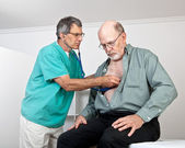Doctor or Nurse Listens to Older Patient's Heart and Lungs — Stock Photo