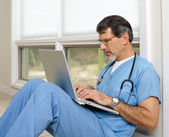 Doctor Reviewing and Researching on Laptop Computer — Foto de Stock