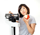 Woman on Weight Scale Puzzled About Diet Plans — Stock Photo