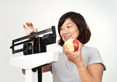 Woman on Weight Scale Pleased with Her Weight Loss — Stock Photo
