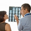 Doctor and Patient Viewing Spinal MRI Scans — Stock Photo