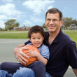Royalty-Free Stock Photo: Family Basketball Grandfather and Grandson in the Park