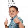 Royalty-Free Stock Photo: Little Boy Happy with Glasses at Optometrist\'s Office