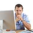 Worried Man at Desk and Computer Paying Bills — Stock Photo