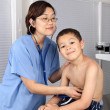 Royalty-Free Stock Photo: Little Boy at the Doctor Being Examined by Doctor or Nurse