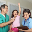 Little Girl at Doctor&#039;s Office with Nurse and Doctor - Stock Photo