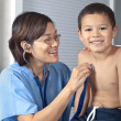 Young Boy with Female Doctor or Nurse - Stock Photo