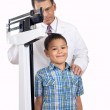 Doctor Weighing Little Boy on Weight Scale — Stock Photo