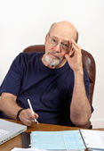 Senior Man with Checkbook Paying Bills and Worrying — Stock Photo