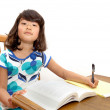 Girl studying at desk - Stok fotoğraf