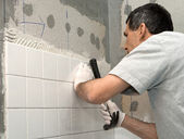 Man Tiling A Wall — Stock Photo
