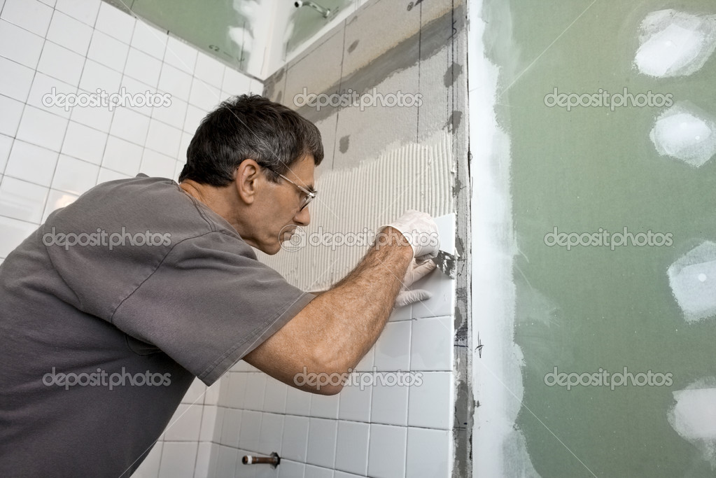 Man Tiling A Bathroom Wall u2014 Stock Photo u00a9 forestpath #9671786