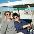 Seniors in Golfcart at the Beach — Stock Photo
