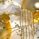 Golden Christmas Ornaments and Shiny Ribbon — Stock Photo #9698888