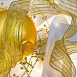 Golden Christmas Baubles and Ribbons — Stock Photo #9698909