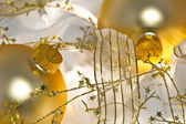 Golden Christmas Ornaments and Shiny Ribbon — Стоковое фото