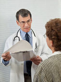 Doctor Discussing Medical Report with Female Patient — Stock Photo