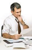 Confused Man Reading a Bill or Bank Statement — Stock Photo