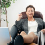 Female Executive with Feet on Desk — Stock Photo